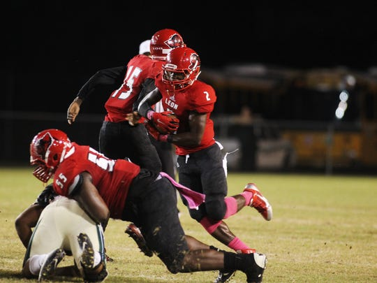 Leon High running back James Peterson carries the passed