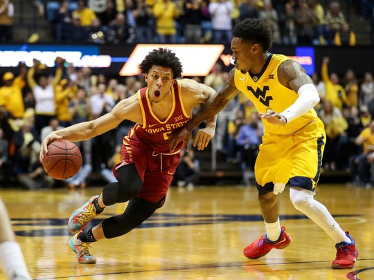 Iowa State guard Lindell Wigginton drives against West Virginia Mountaineers guard Daxter Miles Jr. during their game at WVU Coliseum on Feb. 24, 2018, on Morgantown, West Virginia.