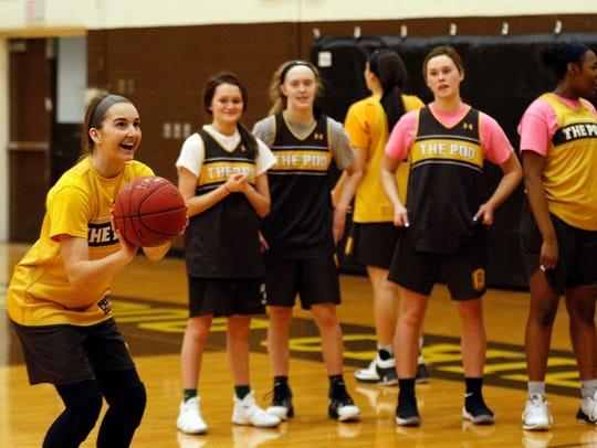 Jordan Wersinger shoots free throws as her teammates