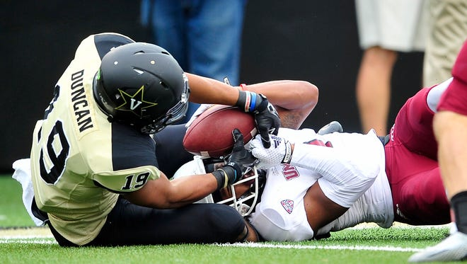 Vanderbilt receiver C.J. Duncan (19) steals the ball from UMass defender Randall Jette on a broken play late in the fourth quarter Saturday. The Commodores scored the eventual winning touchdown on the next play.