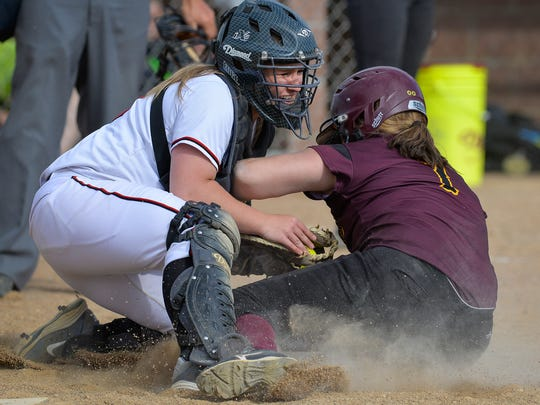 Rocori High School catcher Kendra Swanson (10) holds on to the ball for an out at home plate despite a collision with the baserunner, Fergus Falls' Lydia Mann (7) in the sixth inning of their first game Tuesday evening at Rocori. Rocori won the first game 6-1.