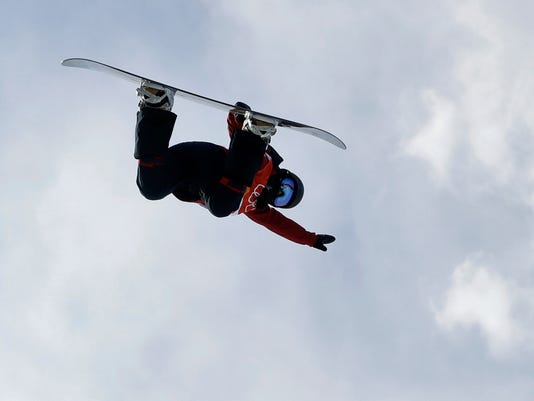 Liu Jiayu, of China, jumps during the women's halfpipe qualifying at Phoenix Snow Park at the 2018 Winter Olympics in Pyeongchang, South Korea, Monday, Feb. 12, 2018. (AP Photo/Kin Cheung)