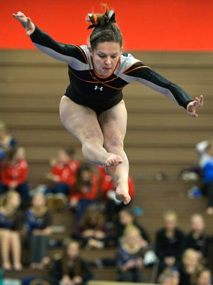 St. Cloud Tech junior Lara Aycock takes flight during her balance beam routine Dec. 5, 2015, in the St. Cloud Apollo Gymnastics Invitational.