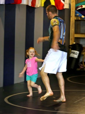 Savannah Holbrook, then 3, ran laps with her father, local MMA fighter Andrew Holbrook, a year ago at  Indy Boxing and Grappling gym,