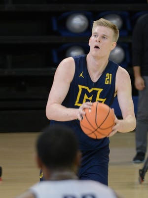 Marquette center Harry Froling looks for a shot at practice on Saturday. Froling, a transfer from SMU, is eligible to play on Monday.