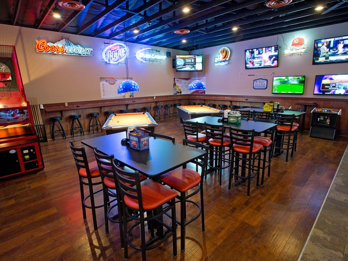 Take a look inside Longnecks Sports Grill, which recently reopened in Wilder after a fire. The area by the bar has games and flat screens for the patron's entertainment.