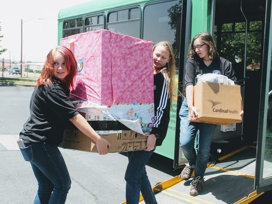 Junior Leadership Otero advocates deliver a box full of goodies to the Children, Youth and Families Department of Otero and Lincoln counties Monday for foster children in their foster care.