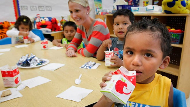 Mario Rojas has a snack with other kids at Centro Hispano's Head Start dual language program in September 2015. The nonprofit organization relinquished its federal Head Start funding in October, rather than face termination by the federal agency overseeing Head Start because of financial mismanagement.