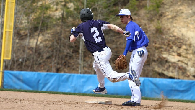Brian Jordan of Brighton races for a triple in a baseball game in Charleston, West Virginia, on Tuesday, March 31, 2015..