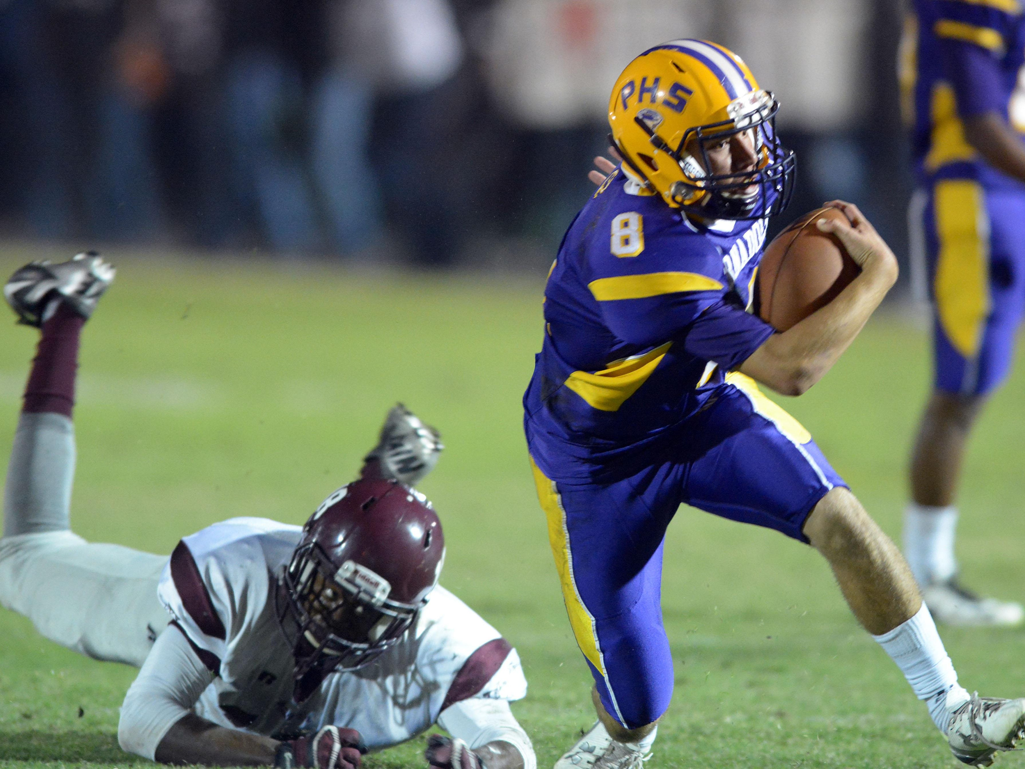 Purvis quarterback Ty Howell runs the ball Friday night against Forrest County AHS.