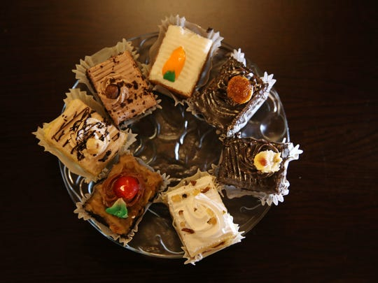 Mini assorted fancy pastries are served up for desert at the Schoen Place wine bar.