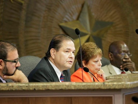 City Rep. Larry Romero answers a question from fellow Rep. Claudia Ordaz at a recent council meeting.