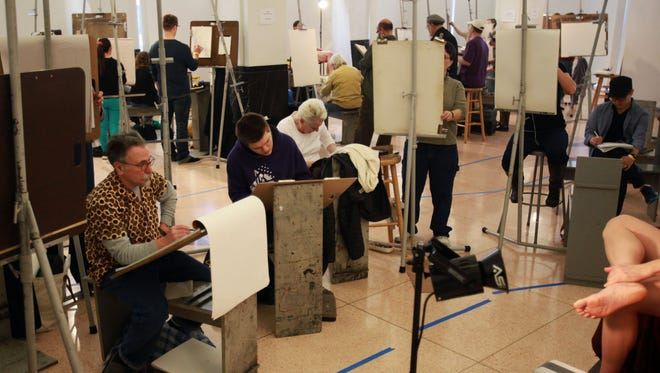 Artists and models take part in Delaware College of Art and Design's Drawing Marathon.