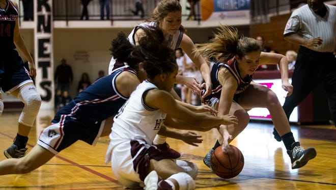 Flour Bluff and Veterans Memorial players fight for the ball during their game Friday, Feb. 2, 2018 at Flour Bluff High School.