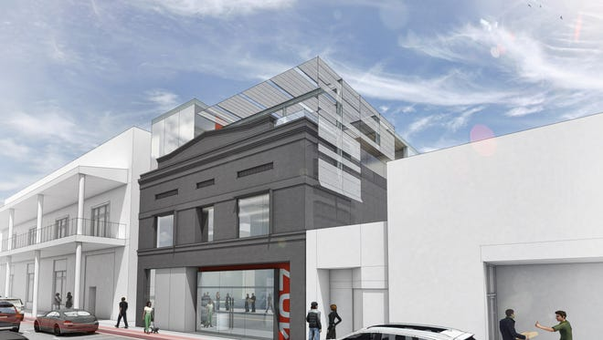 A building at 107 W. College Avenue is slated for major redevelopment.