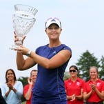 Anna Nordqvist, of Sweden, holds the trophy as she celebrates winning the ShopRite LPGA Classic golf tournament, Sunday, June 5, 2016, in Galloway Township, N.J.