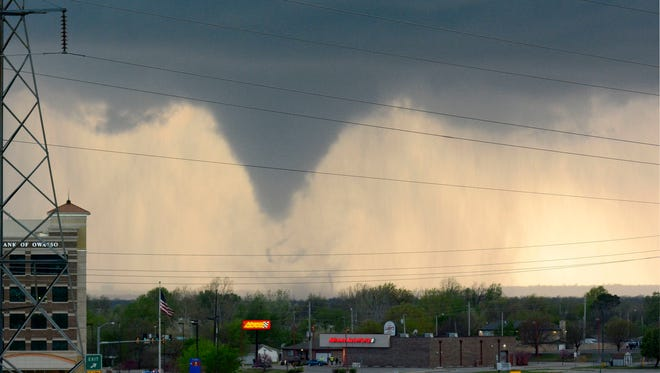 A tornado is shown touching down in the Tulsa, Okla., area  on March 30.