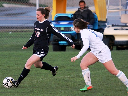 Northville's Jenna Marotta (left) goes on the attack in Tuesday's 0-0 tie against Salem.