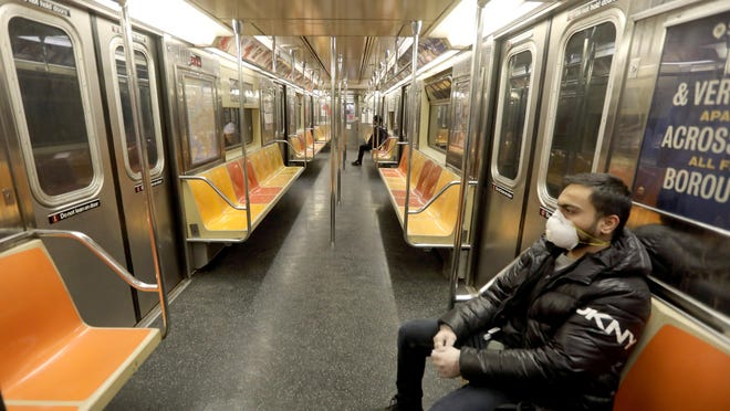 Yash Barot, Metropolitan Transit Authority employee, had a New York City subway car almost all to himself March 21, 2020. Coronavirus concerns have closed almost all businesses, kept most New Yorkers indoors, and emptied out the New York City subway system.