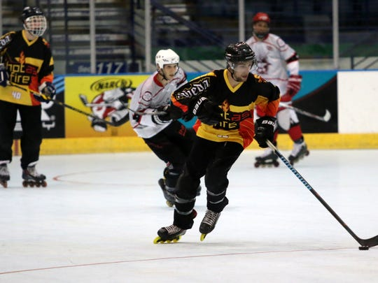 A Hot As Fire player skates up the ice during the NARCh