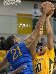 Delaware's Marvin King-Davis (21) blocks a shot by Towson's John Davis on Saturday in Towson, Md.