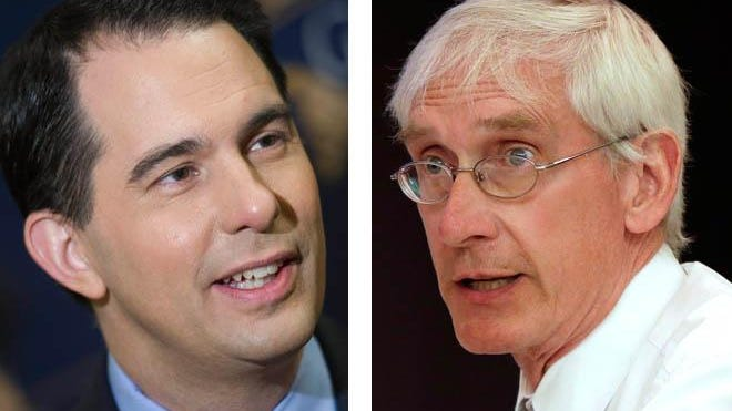 State Superintendent Tony Evers (right) had argued against the 2011 law backed by Gov. Scott Walker.