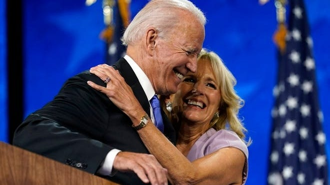 Democratic presidential candidate former Vice President Joe Biden hugs his wide Jill Biden after his speech during the fourth day of the Democratic National Convention, Thursday, Aug. 20, 2020, at the Chase Center in Wilmington, Delaware.