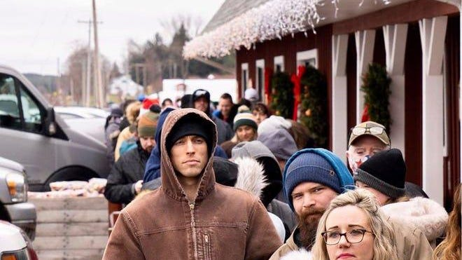 People line up Saturday for the Country Christmas at Friske Farm Market in Antrim County in northern Michigan.