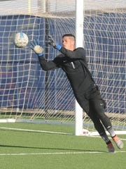 Cooper goalie Nick Silva makes a stop in the first half against Amarillo Palo Duro. Palo Duro won the Region I-5A bi-district playoff game 3-2 in overtime Friday, March 24, 2017 at Frenship's Tiger Soccer Stadium in Wolfforth.