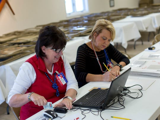 Election Officials Lucie DeLine and Tina Stocker prepare ballots for voters Tuesday, November 3, 2015 at the Masonic Temple in Marysville.