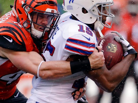 Buffalo Bills wide receiver Brandon Tate (15) is tackled by Cincinnati Bengals strong safety Clayton Fejedelem, left, in the first half of an NFL football game, Sunday, Oct. 8, 2017, in Cincinnati.