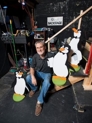 """Director Stephen Lott poses with his penguin prop friends that were made for the upcoming production of """"Mary Poppins"""" at the Pensacola Little Theatre in Pensacola on Friday, July 6, 2018."""
