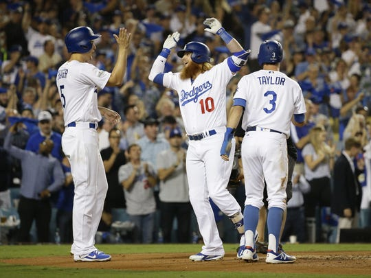 Los Angeles Dodgers Justin Turner (10) hits a 3-run home run against the Arizona Diamondbacks in the 1st inning during Game 1 of the NLDS on Friday, Oct. 6, 2017 at Dodger Stadium in Los Angeles, California.