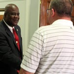 Hattiesburg police chief nominee Anthony L. Parker, left, greets Hattiesburg City Council President Kim Bradley on June 16.