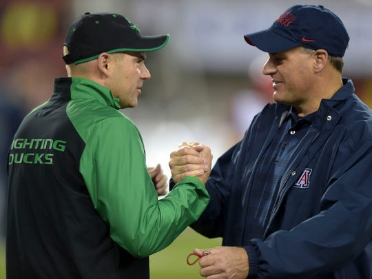 Rodriguez and Oregon coach  Mark Helfrich dig into