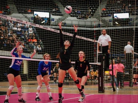Janesville junior Alisa Bengen sets the ball against Holy Trinity in their Class 1A match during the 2017 Iowa high school state volleyball tournament on Thursday, Nov. 9, 2017, in Cedar Rapids.