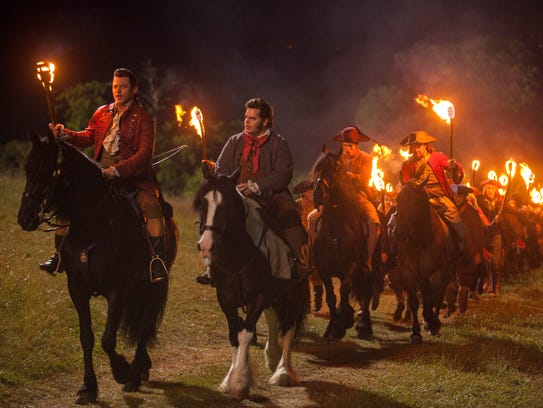 Gaston (Luke Evans) and LeFou (Josh Gad) lead a bunch