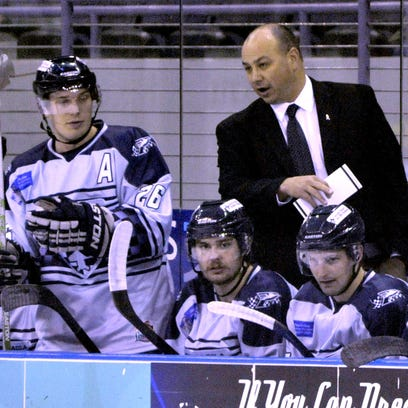 Pensacola Ice Flyers head coach Rod Aldoff, right, expects to return for 2015-16 season.