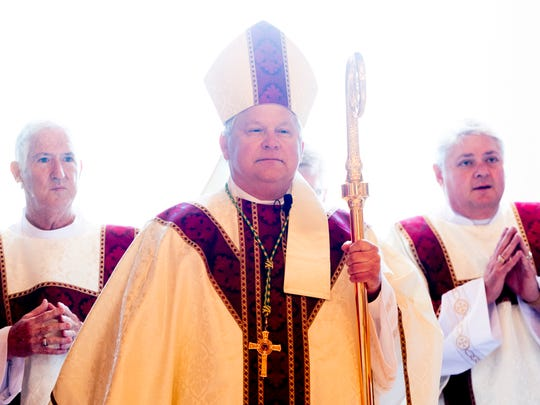 Knoxville Bishop Richard F. Stika enters through the front doors at the Mass and Rite of Dedication of the Cathedral of the Most Sacred Heart of Jesus in Knoxville, Tennessee on Friday, January 1, 2016