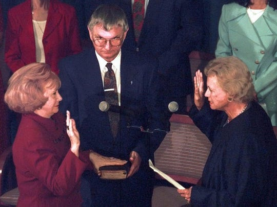 Arizona Gov. Jane Dee Hull (left) takes the oath of office on Sept. 9, 1997, from U.S. Supreme Court Justice Sandra Day O'Connor at the state Capitol.