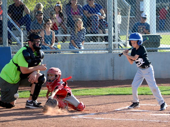 Youth baseball action Wednesday at Bob Forrest Youth Sports Complex.