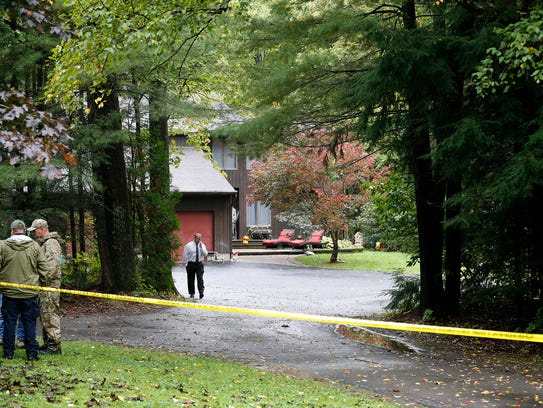 Police investigate at the residence of Thomas and Kelley