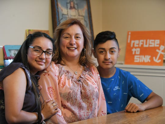 Cindy Garcia with her children, Soleil, 15, left, and Jorge, Jr., 13, at their home in Lincoln Park.