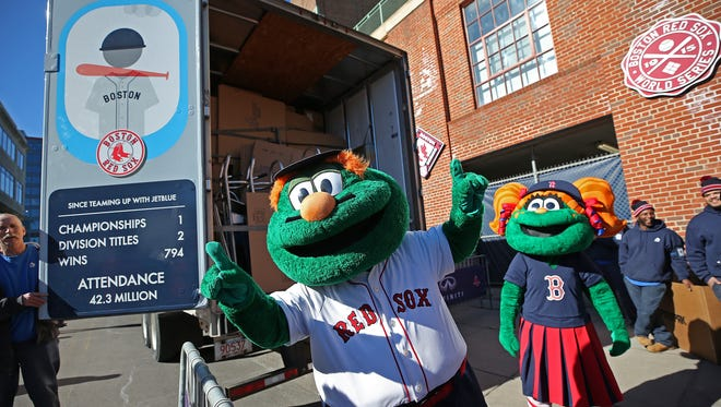 Wally greets fans at Fenway Park who gathered to send off the Red Sox equipment truck as it left for JetBlue Park in Fort Myers on Monday.