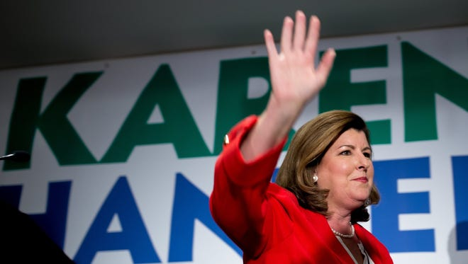 Karen Handel waves to supporters during an election party in Atlanta.