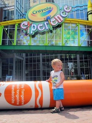 William Schmid, 18 months, of Gardners, Pa., plays outside the Crayola Experience attraction Tuesday, July 29, 2014, in Easton, Pa. Crayola announced Tuesday it will build a second attraction at The Florida Mall in Orlando, Fla., to open in summer 2015.