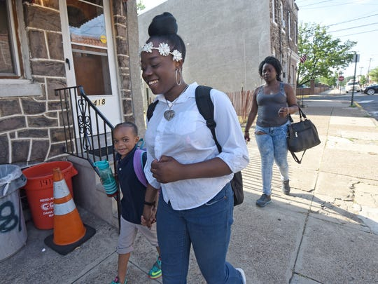 """Tiara Townsend walks daughters Ajiyah, 13, and Aziniyah, 6, to Wiggins Elementary School every morning. """"I've been trying to get bus tickets"""" from the school district, she says, """"and they say they live too close to get a bus."""""""