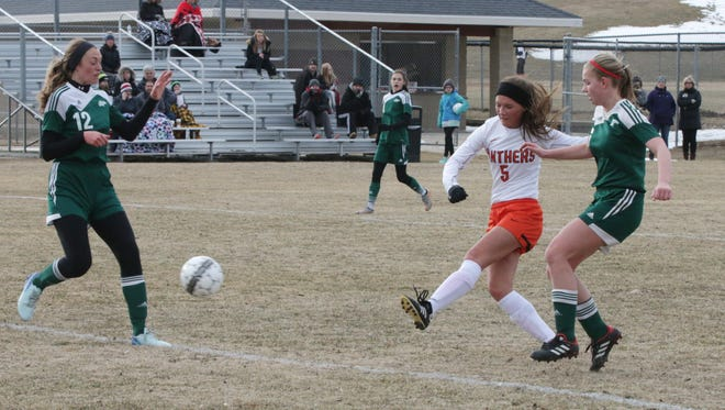 Plymouth's Sydney Robinson (5) takes a shot on goal against Kettle Moraine Lutheran on April 10.