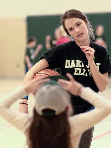 MSU freshman Cassie Harris, 18, gives her sister Clare