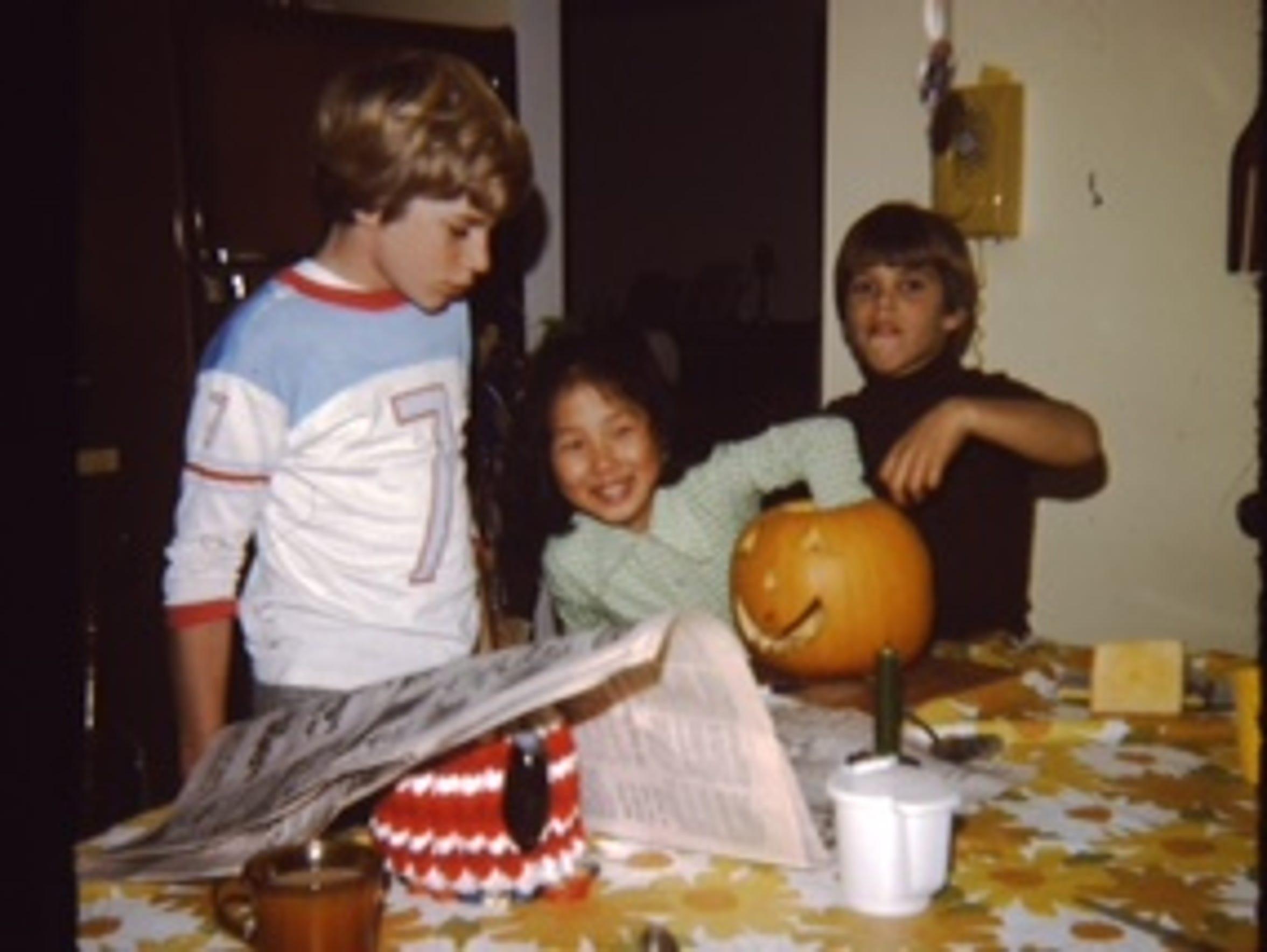 A young Kim Pegula, center, carving pumpkins with her